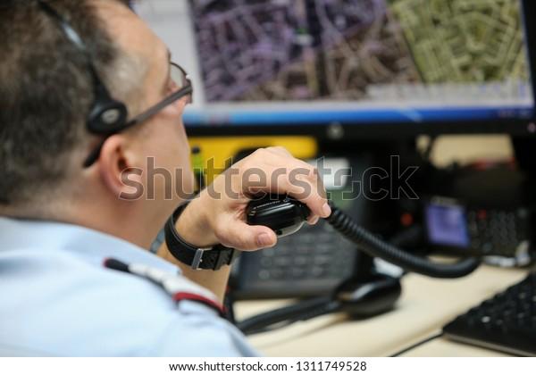 Bucharest, Romania - February 11, 2019: 112 emergency number operator (Romanian version of 911) having a conversation with a distress caller