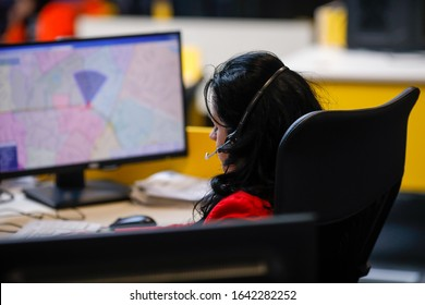 Bucharest, Romania - February 11, 2020: Shallow depth of field (selective focus) image with 112 emergency number operator (Romanian version of 911) having a conversation with a distress caller