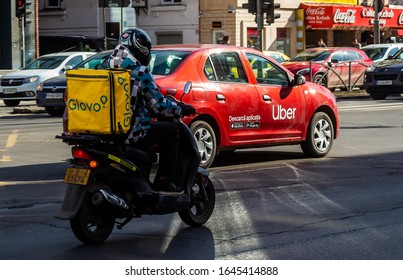 Bucharest, Romania - February 13, 2020: An Uber logo branded car is seen in traffic on a street in downtown Bucharest.