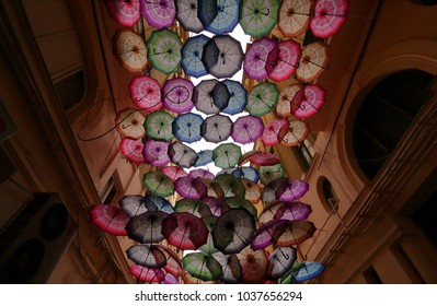 Bucharest, Romania - February 16, 2018: More colorful umbrellas are suspended above the Victoria Passage in Bucharest, romania.