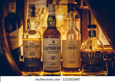 Bucharest Romania - February 19, 2019: Various bottles of alcohol are displayed in bar in Bucharest, Romania.