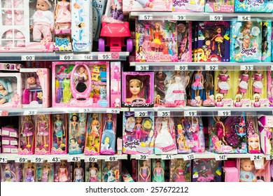BUCHAREST, ROMANIA - FEBRUARY 28, 2015: Barbie Toys For Girls And Other Baby Toys On Supermarket Stand.