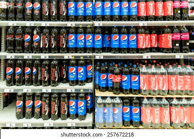BUCHAREST, ROMANIA - FEBRUARY 28, 2015: Pepsi And Coca Cola Soda Drinks On Supermarket Stand.