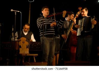 BUCHAREST, ROMANIA - JAN 29 : Taraful Marsa and Nea' Vasile perform at Clubul Taranului January 29, 2011 in Bucharest.