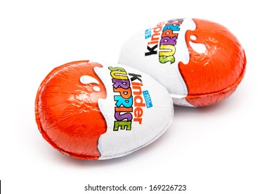 BUCHAREST, ROMANIA - JANUARY 01, 2014: Kinder Surprise Chocolate Eggs On White Background. Is a confection manufactured by Ferrero company and has the form of a chocolate egg containing a small toy.