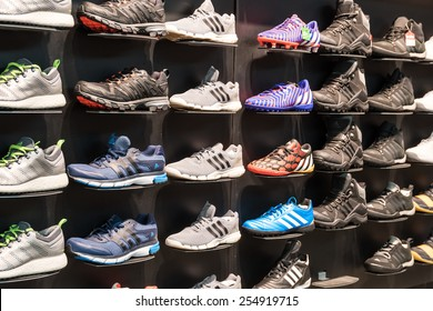 BUCHAREST, ROMANIA - JANUARY 03, 2015: Adidas Shoes In Shoe Store Display. Is a German multinational corporation that designs and manufactures sports clothing and accessories based in Germany.