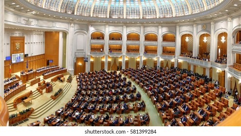 Bucharest, Romania - January 04, 2017: Members of Romanian Parliament and Government listen the speech of  Liviu Dragnea, leader of Social Democratic Party (PSD), in the reunited plenum of Parliament.