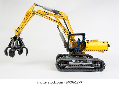 Bucharest, Romania - January 1, 2015: Lego technic excavator on white background.  Lego is a danish toy manufacturer.