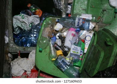 Bucharest, Romania - January 1, 2019: Full of garbage and very dirty dumpsters inside a tall block of flats in Bucharest.
