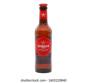 BUCHAREST, ROMANIA - JANUARY 1, 2020. Bottle of Estrella Damm beer isolated on white background. Estrella Damm is a pilsner beer, brewed in Barcelona.