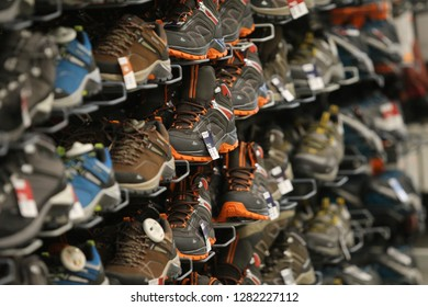 Bucharest, Romania - January 12, 2019: Quechua brand winter sneakers on a shelf in the French sporting goods retailer Decathlon, in Bucharest.