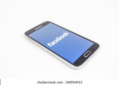 Bucharest, Romania - January 1st, 2015: Brand new black Samsung Galaxy S5 on white background. Facebook is an online social networking service headquartered in Menlo Park, California.