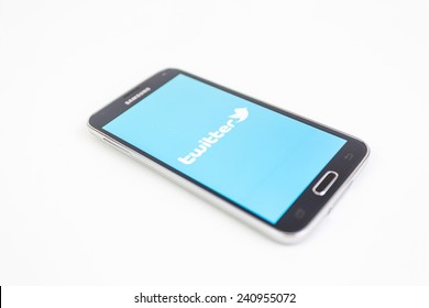 Bucharest, Romania - January 1st, 2015: Brand new black Samsung Galaxy S5 on white background. Twitter is an online social networking service that enables users to send and read short messages.