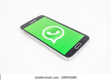 Bucharest, Romania - January 1st, 2015: Brand new black Samsung Galaxy S5 on white background. WhatsApp is an instant messaging app for smartphones that operates under a subscription business model.