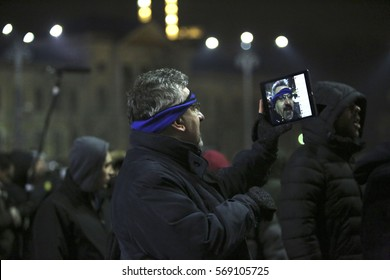Bucharest, Romania - January 31, 2017: People are live broadcasting on Facebook from the protest rally in front of Romanian headquarter against the decision prisoner pardon especially for corruption.