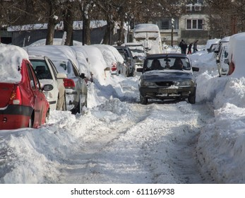 BUCHAREST, ROMANIA, January 4, 2008: A car is seen on a street covered in snow, after a winter storm in Bucharest.
