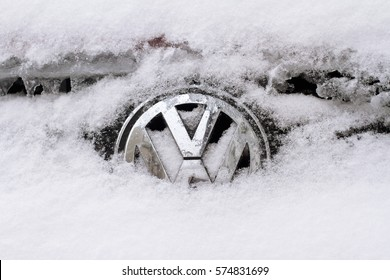 BUCHAREST, ROMANIA - JANUARY 5, 2017: Close up of a Volkswagen chrome car brand logo covered in snow