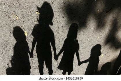 Bucharest, Romania - July 01, 2019: The shadow of a horo dance made by children is seen at the official opening of the summer kindergartens in Bucharest. This image is for editorial use only.