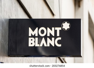 """BUCHAREST, ROMANIA - JULY 06, 2014: Mont Blanc Sign. Founded in 1906 it is a German manufacturer of writing instruments, watches, jewellery and leather goods often identified by their """"White Star""""."""