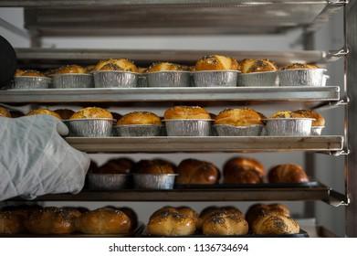 BUCHAREST, ROMANIA - JULY 1, 2018 Making bread buns in a bakery