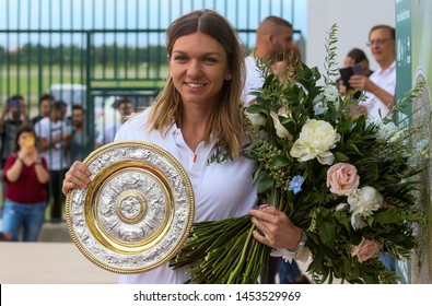 Bucharest, Romania - July 15, 2019: Wimbledon women's singles tennis champion Simona Halep poses with her replica of the Wimbledon trophy at her arrival ceremony at Henri Coanda Airport in Bucharest