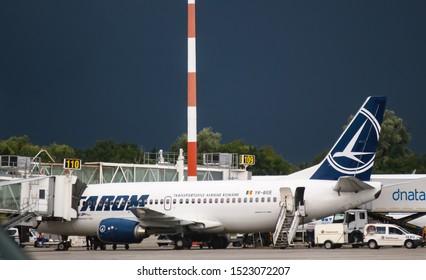 Bucharest, Romania - July 15, 2019: Tarom, YR-BGE, Boeing 737-300, MSN 27395, aircraft, named Timisoara, is seen on passenger boarding bridge on the ramp of Henri Coanda Airport in Otopeni.