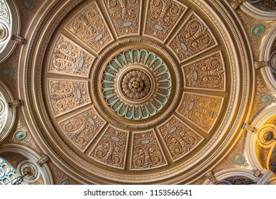 Bucharest, Romania - July 17, 2018: Interior and the ceiling of the cozy and impressive concert hall in Romanian Athenaeum (Ateneul Roman or Romanian Opera House) in Bucuresti, Romania