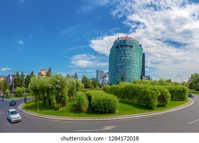 BUCHAREST, ROMANIA - JULY 17, 2018: The green intersection of Charles de Goulle Square, with Vodafone Romania building in the background.