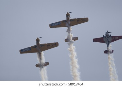 BUCHAREST, ROMANIA - JULY 17: Acrobatic airplanes perform during the airshow on July 17, 2010 on Henri Coanda airport, Bucharest, Romania.