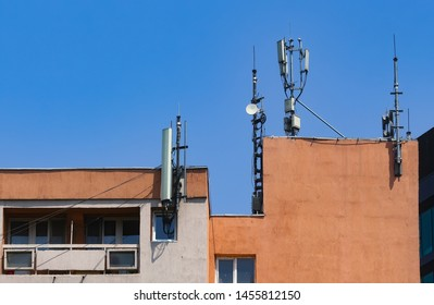 Bucharest, Romania - July 18, 2019: Many GSM telecommunications antennas are installed dangerously very close to the apartments located in a building in Bucharest. This image is for editorial use only
