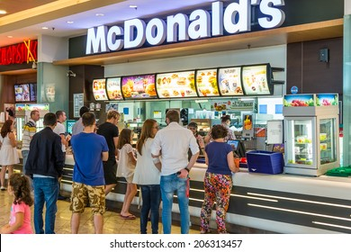 BUCHAREST, ROMANIA - JULY 20, 2014: People buying fast-food from McDonald's Restaurant. McDonald's is the main fast-food restaurant chain in Romania.