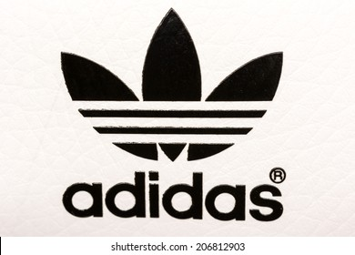 BUCHAREST, ROMANIA - JULY 23, 2014: Adidas Sign On Adidas Sport Shoes. Founded in 1924 is a German multinational corporation that designs and manufactures sports shoes, clothing and accessories.