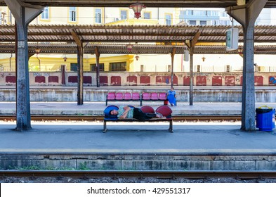 BUCHAREST, ROMANIA - JULY 24, 2015: An unidentified man sleeps in the train station.