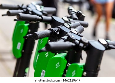 Bucharest, Romania - July 25, 2019: Several Lime-S Electric Scooters are parked on a sidewalk in Bucharest. This image is for editorial use only.