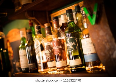 Bucharest Romania - July 29, 2018: Illustrative editorial image of various bottles of alcohol are displayed in bar in Bucharest, Romania.
