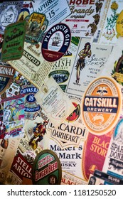 Bucharest, Romania - July 29, 2018: Illustrative-editorial image of various alcohol labels are displayed on a wall in a pub in Bucharest, Romania.