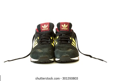 Bucharest, Romania - July 6, 2015: Isolated Adidas zx 700 shoes on white background . Studio shoot. For a sporty look and feel this version of the Zx700 running shoe treats the 1980's.