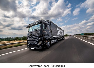 BUCHAREST ROMANIA July 9 2016 Black Mercedes-Benz Actros 1845 Euro 6 truck trailer in traffic. Mercedes-Benz Actros wins The Green Truck Award 2015