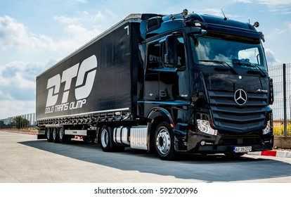 BUCHAREST ROMANIA July 9 2016 Black Mercedes-Benz Actros 1845 Euro 6 truck trailer in traffic. Mercedes-Benz Actros wins The Green Truck Award 2015.