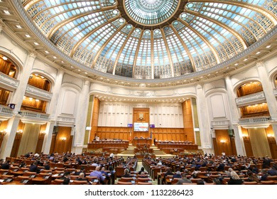 BUCHAREST, ROMANIA - JULY 9, 2018: Members of the Chamber of Deputies (one of the two chambers of Romanian Parliament, the other one being the Senate) attend a meeting in the Palace of Parliament.