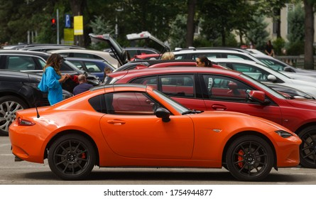 Bucharest, Romania - June 01, 2020: An orange Mazda MX5 car is parked in downtown Bucharest. This image is for editorial use only.