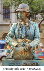 Bucharest, Romania - June 10, 2016: Coco Chanel living statue at B-FIT in the Street. B-FIT is a cultural event that involves international artists and acrobats, who act in theater plays on street.