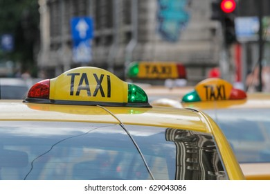 BUCHAREST, ROMANIA, June 11, 2016: Close up on a yellow taxi cab sign.