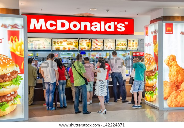 BUCHAREST, ROMANIA - JUNE 13: People buying fast-food from McDonald's Restaurant on June 13, 2013 in Bucharest, Romania. McDonald's is the main fast-food restaurant chain in Romania.