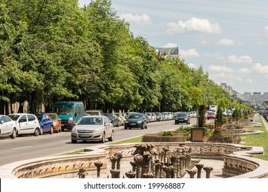 BUCHAREST, ROMANIA - JUNE 13: Rush Hour Traffic On Unification Boulevard on June 13, 2014 in Bucharest, Romania. Bulevardul Unirii (Unification Boulevard) is a major thoroughfare in central Bucharest.
