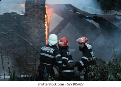 BUCHAREST, ROMANIA, June 14, 2016: Fire fighters taking control of a building fire in Bucharest.