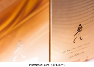 BUCHAREST, ROMANIA - JUNE 17, 2018: closeup of Johnny Walker blended whisky packaging box standing on supermarket shelves