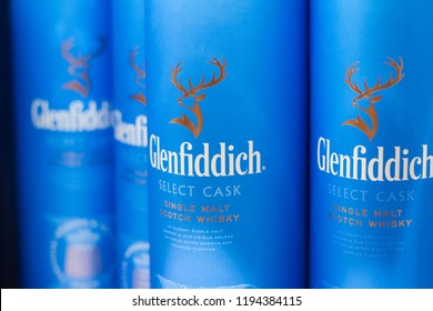 BUCHAREST, ROMANIA - JUNE 17, 2018: closeup of Glenfiddich single malt Scotch blue packaging boxes on supermarket shelves