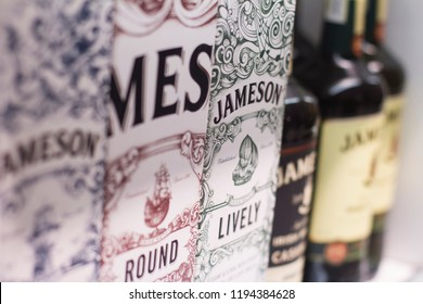 BUCHAREST, ROMANIA - JUNE 17, 2018: closeup of Irish Jameson whiskey packaging boxes and bottles with different flavors and label design standing on supermarket shelves
