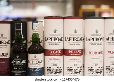 BUCHAREST, ROMANIA - JUNE 17, 2018: closeup of Laphroaig single malt Scotch Islay whisky bottles and packaging boxes with different flavors and label design standing on supermarket shelves